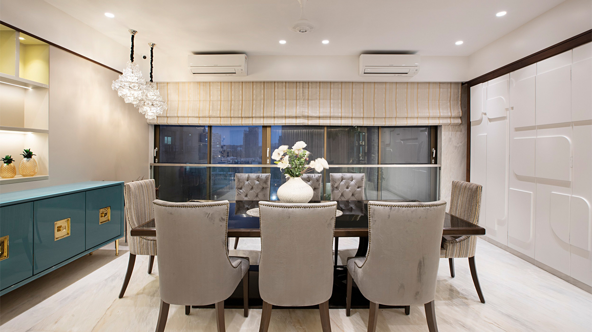 The living room is divided into the living and dining space
