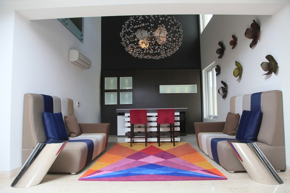 Punam Kalra, The Centre for Applied Arts, Lajpat Nagar, Luxury Villa, Omaxe Group, Luxury Villa Omaxe Group Project, Mullanpur, Acrylic solid surfaces, Zen and modern, Colorful geometric carpet, Monochrome carpet, Orange tree-shaped shelf, Wooden planked bed, Avant-garde, Metallic glamour