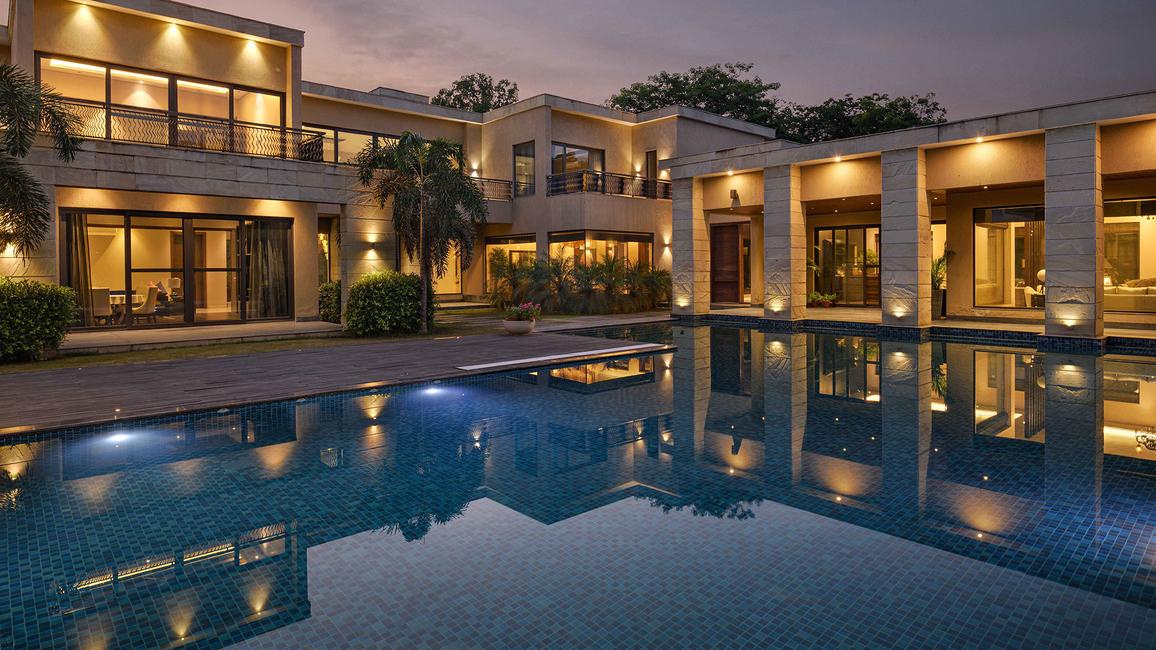 Aparna Kaushik, Swimming pool designs, Contemporary Farmhouses, Stone facade, HPL Facade, Travertine stones, Kharad stones, Labradorite Dark stone, Wooden deck tiles