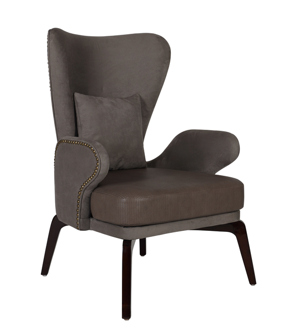 This beautiful bespoke winged chair impresses with its perfect proportions. A mix of fabrics for upholstery in a strong shade and rivets give it a classic appeal.